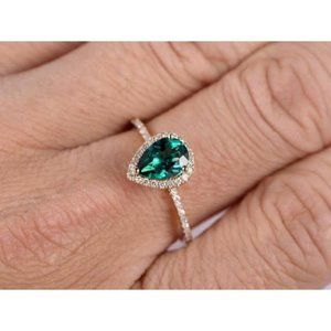 3.8 Ct Pear Shaped Green Emerald With Diamond Ring